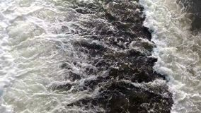 Rapid flow of water in the river stock video