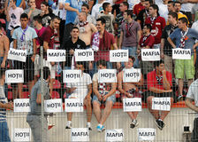 Rapid football fans with messages against Romanian Football Federation. The Rapid Bucharest  supporters displayed messages against Romanian Football Federation Royalty Free Stock Photos