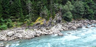 Rapid mountain river. High in the mountains Stock Photo