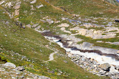 Rapid mountain stream, footpath and bridge, Hohe Tauern Alps, Austria Stock Image