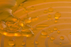 Rapid orange water. Over orange background with waves Royalty Free Stock Photos