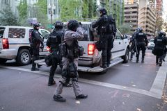 Rapid response mobile police unit during civil disobedience event, in Portland, Oregon. stock photos