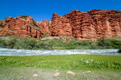 Rapid river and strange red rock formations Stock Image