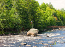 A rapid river in the summertime Royalty Free Stock Photo