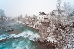 Rapid rocky river in winter. Skofja Loka. Rapid rocky river in winter. Small Slovenian town Skofja Loka Stock Image