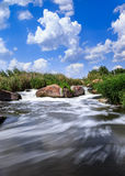 Rapid stream 3. Rapidly flowing river among granite rocks and foliage Stock Images