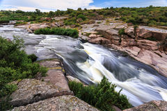 Rapid stream 2. Rapidly flowing river among granite rocks and foliage Stock Image