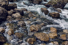Rapid stream with rocks and moss Stock Photo