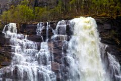 Rapid stream of water falling from a cliff Stock Image