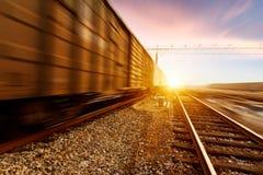 Rapid train runs on tracks Royalty Free Stock Image