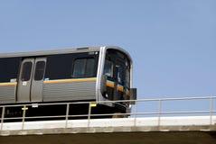 Rapid Transit. Train running on overhead bridge through the city royalty free stock photos