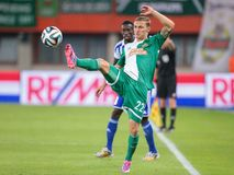 Rapid vs. Helsinki. VIENNA, AUSTRIA - AUGUST 28, 2014: Mario Pavelic (#22 Rapid) kicks the ball in an UEFA Europa League qualifying game Stock Images