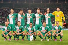 Rapid vs. Helsinki. VIENNA, AUSTRIA - AUGUST 28, 2014: The team of SK Rapid poses before the Europa League qualifier against HJK Helsinki before an UEFA Europa royalty free stock photo