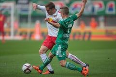Rapid vs. Salzburg. VIENNA, AUSTRIA - OCTOBER 4, 2015: Benno Schmitz (RB Salzburg) and Philipp Schobesberger (SK Rapid) fight for the ball in an Austrian Stock Images