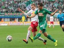 Rapid vs. Salzburg. VIENNA, AUSTRIA - OCTOBER 4, 2015: Benno Schmitz (RB Salzburg) and Stefan Schwab (SK Rapid) fight for the ball in an Austrian Football League Stock Images