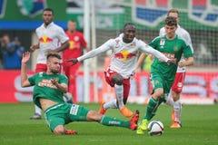 Rapid vs. Salzburg. VIENNA, AUSTRIA - OCTOBER 4, 2015: Phillipp Prosenik (SK Rapid) and Naby Keita (RB Salzburg) fight for the ball in an Austrian Football Stock Photos