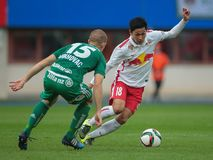 Rapid vs. Salzburg. VIENNA, AUSTRIA - OCTOBER 4, 2015: Srdjan Grahovac (SK Rapid) and Takumi Minamino (RB Salzburg) fight for the ball in an Austrian Football Stock Photo