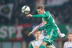 Rapid vs. Sturm Graz. VIENNA, AUSTRIA - FEBRUARY 28, 2015: Daniel Offenbacher (#20 Sturm Graz) and Mario Pavelic (#22 Rapid) fight for the ball in an Austrian Stock Photos