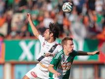 Rapid vs. Wolfsberg. VIENNA, AUSTRIA - SEPTEMBER 20, 2014: Nemanja Rnic (#15 Wolfsberg) and Robert Beric (#9 Rapid) fight for the ball in an Austrian soccer Royalty Free Stock Images