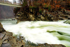 Rapid water of mountain river Royalty Free Stock Photo