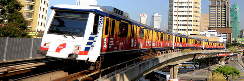 RapidKL or known as LRT ( Light Rail Transit). RapidKL, short for Rangkaian Pengangkutan Integrasi Deras Sdn Bhd, is a government-owned company which was formed Stock Photography