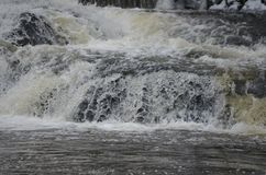 Rapidly flowing water on the winter river royalty free stock photo