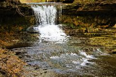 Flowing Waterfall In Ohio. A rapidly flowing waterfall in beautiful Yellow Springs, Ohio Stock Image