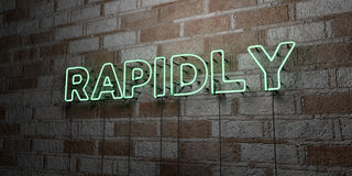 RAPIDLY - Glowing Neon Sign on stonework wall - 3D rendered royalty free stock illustration. Can be used for online banner ads and direct mailers Stock Images