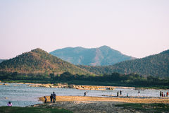 People, rivers and mountains. Kaeng Khut Khui is part of the Mekong River. At the place to come rocks and sandy beaches, people will ride the boat across Stock Photography