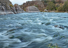 White water rapids. Rapids of the Southern Buh (Yuzhny Bug) river shot with a long exposure in the nature reserve of Buh Hard (Buzhsky Gard&#x29 Royalty Free Stock Image