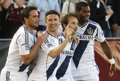 Rapids_Galaxy_26. DENVER - Los Angeles Galaxy players Todd Dunivant, Robbie Keane, Mike Magee and David Lopes celebrate Magee's header goal in a match against Royalty Free Stock Photos