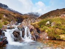Rapids In Small Waterfall On Stream, Higland In Scotland An Early Spring Day. Snowy Mountain Peaks Royalty Free Stock Photo
