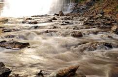 Rapids leading away from waterfall Royalty Free Stock Image