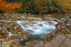 Rapids on a rocky mountain river in autumn. Rapids on a rocky mountain river. Autumn time Stock Images