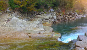 Rapids on a rocky mountain river in autumn. Rapids on a rocky mountain river. Autumn time Royalty Free Stock Images