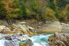 Rapids on a rocky mountain river in autumn Stock Photos