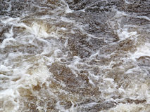 Rapids. Splashy turbulent waves of rapid flowing river Stock Images