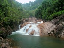 Rapids and waterfalls. Taken in Berkelah Hill, Kuantan, Malaysia. It is a series of waterfalls and rapids. These are the 20metres ones before the main falls Stock Images