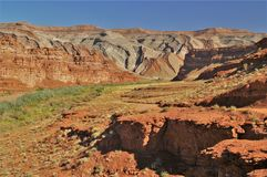 Raplee Ridge in Mexican Hat, Utah. Raplee Ridge, part of the Monument Upwarp in southeastern Utah, is a long, narrow, folded anticline that formed about 70 royalty free stock image