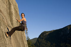 Rappel. A fit and attractive girl climbs a granite rock in Squamish British Columbia Canada Stock Photo