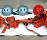 Rappel or Abseil Equipment. Helmets and harnesses are prepared for a rappelling exercise Stock Photos