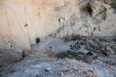 Rappeling at one the Dead Seas canyons stock images