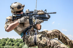 Rappeling with weapons. Soldier during assault rappeling exercises with weapons Stock Images