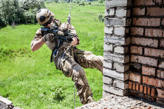 Rappeling with weapons Royalty Free Stock Image