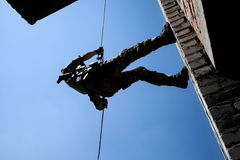 Rappeling with weapons Stock Image