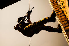 Rappeling with weapons Stock Photos