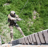 Rappeling with weapons Royalty Free Stock Images