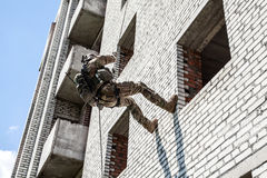 Rappeling with weapons Stock Photography
