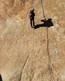 Rappelling. Down the Lowenbrau Pinnacle with a shadow in McCain Valley BLM land outside San Diego California Stock Image