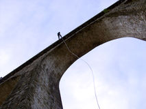 Rappelling from a bridge Royalty Free Stock Image